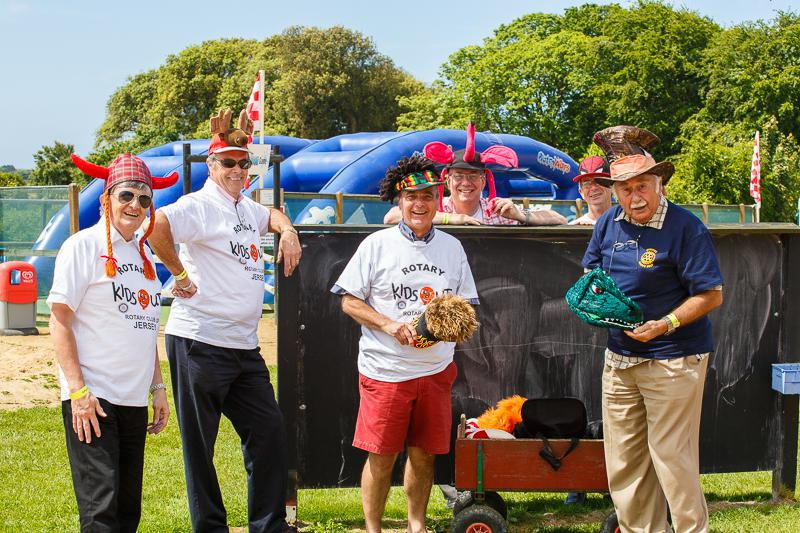 KidsOut Day 2014 - the Rotary helpers get dressed up too. Some sporting hair not seen for many years.