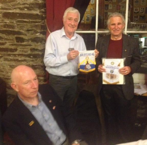 Marathons on South West Coastal Path - President Graham exchanges club banners with Kurt whilst Martin looks on