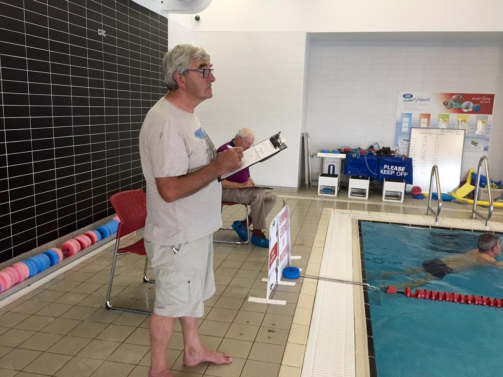 Charity Swimathon 2017 - 2 of the lane marshals keep a strict eye on the swimmers. 'If you don't touch the end of the pool the length doesn't count'. Harsh indeed!