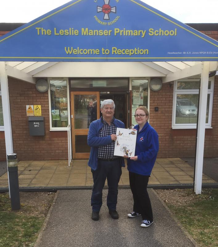 Lost Words For Lincolnshire - Simon Kalson handing over one of the books to English teacher Fiona Malloch-Rear at  the Leslie Manser Primary School