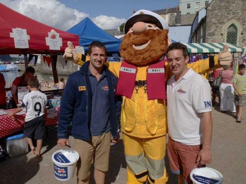 Family Fun Harbour Spectacular 2013 - Lifeboat men Rhys Thomas (left) and Ben Field-Thomas are pictured with RNLI mascot Stormy Stan who made a welcome appearance