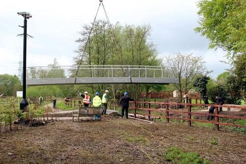 St Catherines Hospice Footbridge Construction - The bridge being carefully lowered onto the bases.