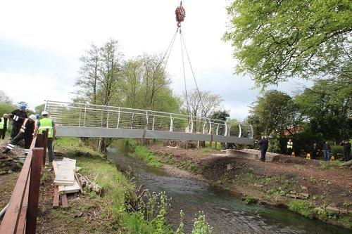 St Catherines Hospice Footbridge Construction - Final postioning of bridge onto bases.