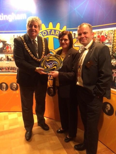 Display banners record 100 year history for Lord Mayor - Lord Mayor Councillor Michael Edwards receiving a decorative plate from Rotarian and glass designer Ingrid Pears and Club President Paul Jones to commemorate the event