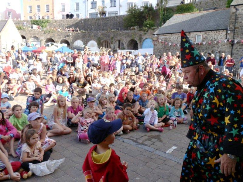 Family Fun Harbour Spectacular 2013 - Magician Philip Jones is pictured with a young helper