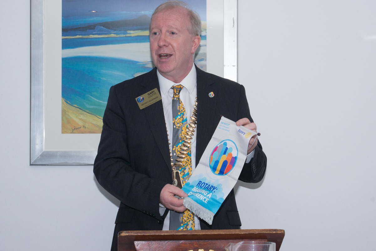 Visit of District Governor Gary Louttit - Gary presenting his year banner with the strapline Making a Difference