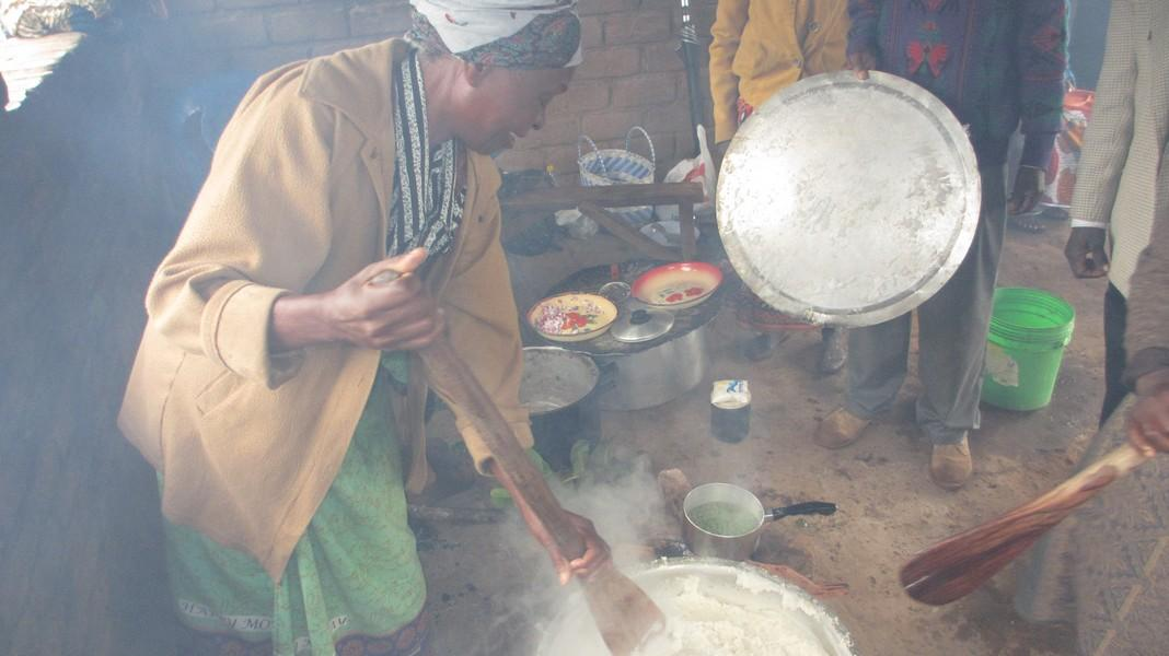 Our Malawi Projects - Cooking the maize