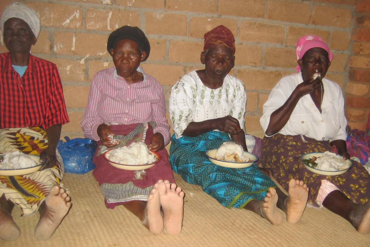 Our Malawi Projects - Enjoying a meal in a good harvest year