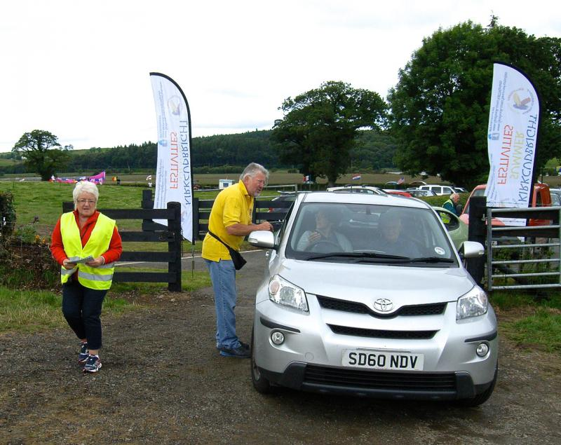 Rotary supports the Summer Festivities at the Carse Country Fair - Maurice and Anne doing their bit!