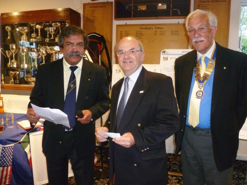 20th Annual Mayor of Truro's Charity Golf Day, 12 May 2017 - Raj Dhumale presents the Rotary Club cheque to Tony Randall of CHICKS