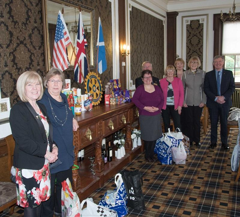 Rotarians donate to the URC Food Angel Foodbank -