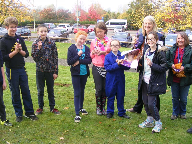 Growing Together to End Polio Now - Students from North Oxfordshire Academy Horticultural Club planted 20,000 corms to brighten up Spiceball Park with drifts of purple come the spring