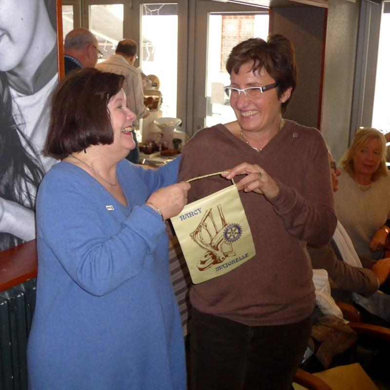 Visits to other clubs - President Christine presenting banner to Sue Clarke from Nancy Majorelle Rotary Club