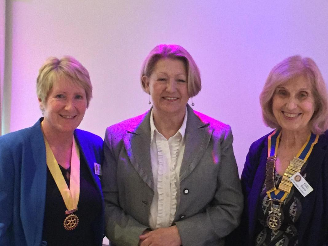 New Members - Sue being welcomed by President Enid and President Elect Jan