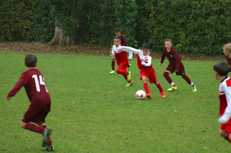 Mount Grace Seven-a-Side Football Tournament - Semi-final action with Oakmere in the red and Cuffley in maroon