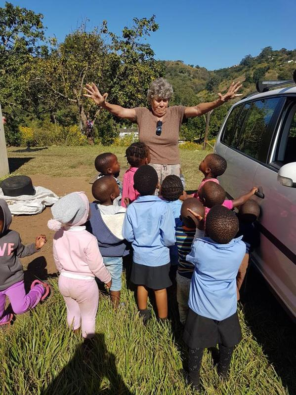 2018/19 Speakers - Olive from Scottsburgh Rotary Club and children from one of her projects in a township in the hills