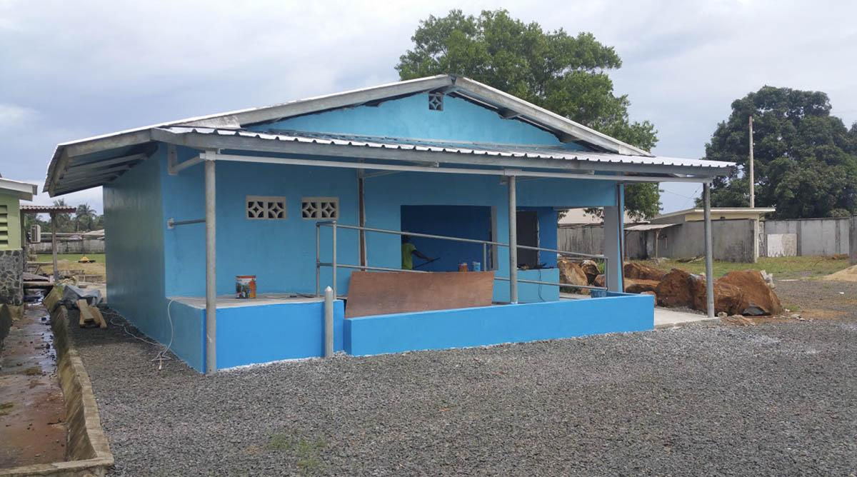 Ebola Treatment and Prevention - The Oxygen plant housing is all but complete and painted bright blue to deter mosquitoes