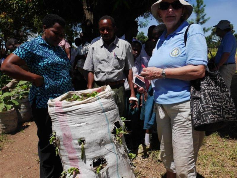 Rotary starts farming project in Tanzanian school - Rtn Chris Philip with community members