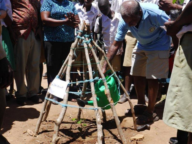 Rotary starts farming project in Tanzanian school - Rtn John Philip waters new planting