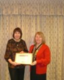 Rotary Community Awards 2011 - Irene Harris receives her Rotary Community Award from President Julie McKenna for her work with children and in particular Baron Road Community Garden