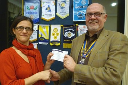 Cheque Presentation in February 2011 - Pres. John presents a cheque to Shen Smallwood from Seaford Down's Syndrome & Special Needs Support Group.