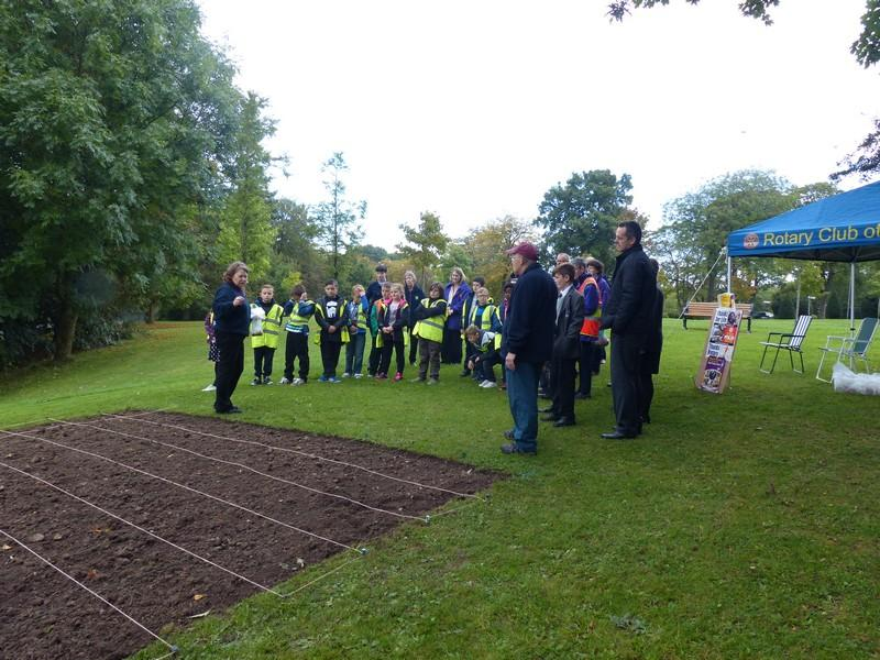 Planting Crocus bulbs at the Town Hall - Children being briefed by Rtn Ross