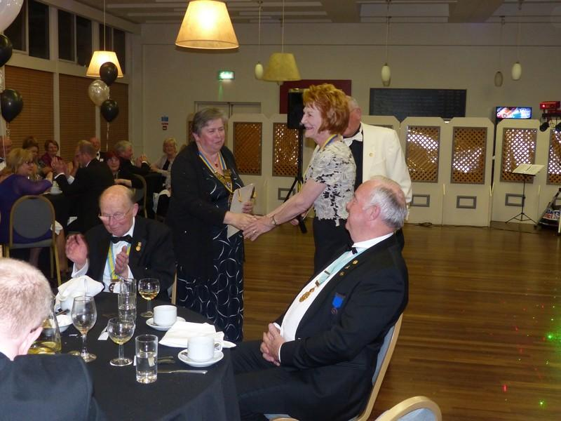 Runcorn Rotary Celebration 70th Dinner/Dance - President Karen accepting a Banner from Rtn Linda Watson PHF from the Club of Chester-Le-Street