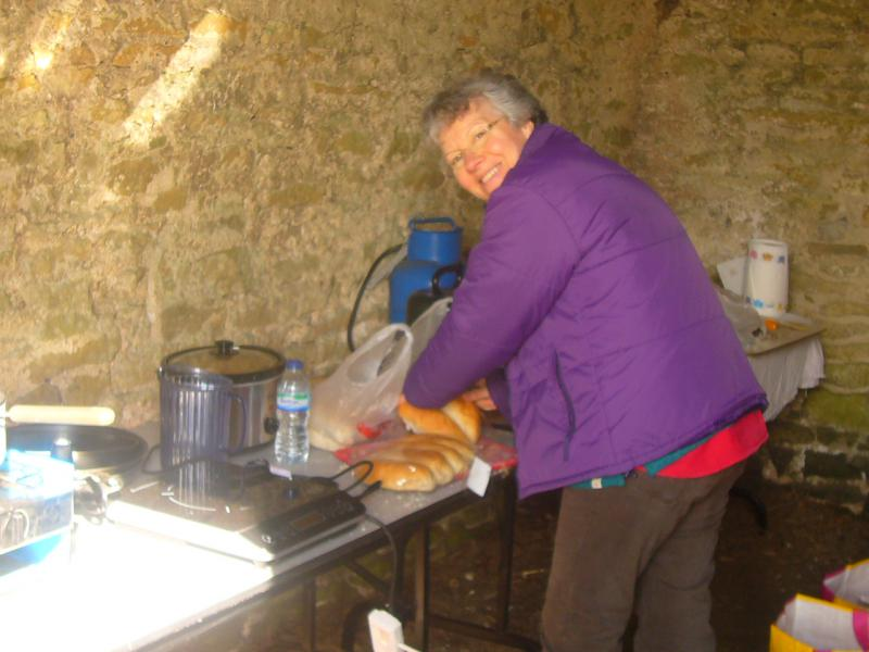 Wensleydale Wander 2013 Report - Gisele cooking the sausages and slicing buns