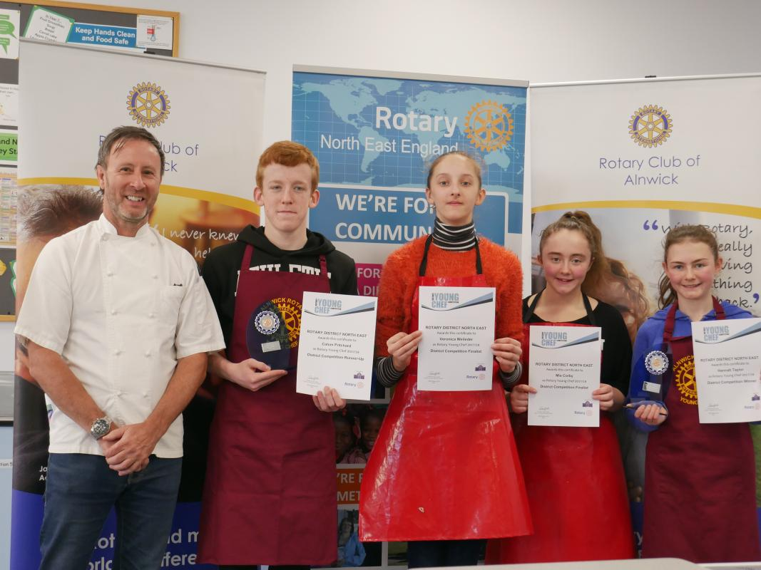 YOUNG CHEF DISTRICT FINAL - Phil Farmer (Judge), Calum Pritchard (runner-up) Veronica Weileder and Mia Corby (Newcastle Gosforth) and Hannah Taylor (Winner)