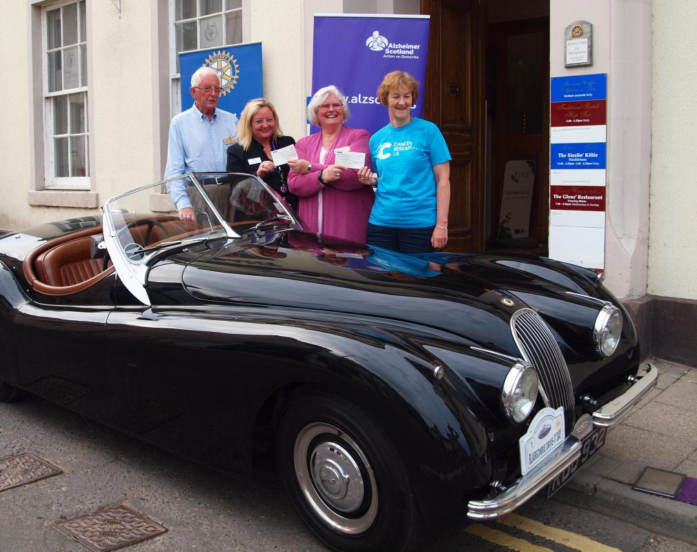 Perthshire Classic Car Festival - President Deborah Rogers & Colin Stewart hand over cheques for £10k to Cancer Research UK & Alzheimer Scotland