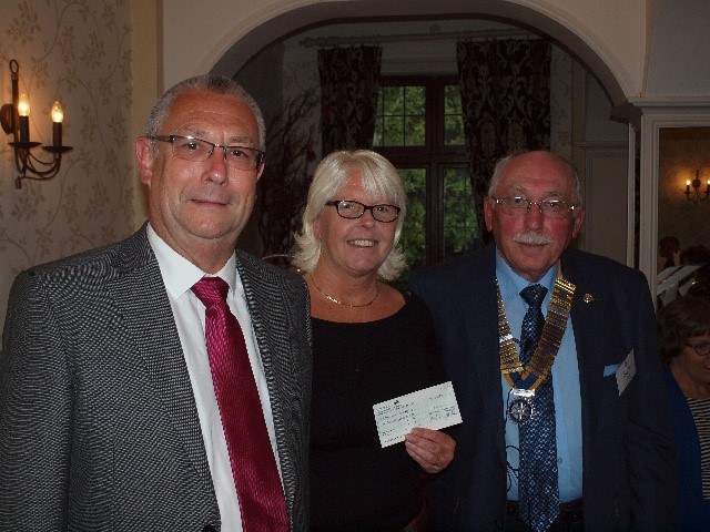 DONATIONS,  PRESENTATIONS AND OTHER SPECIAL OCCASIONS - A/President Sam presents a cheque to Brockenhurst Gateway Club's Pauline and Mark French. See story below.