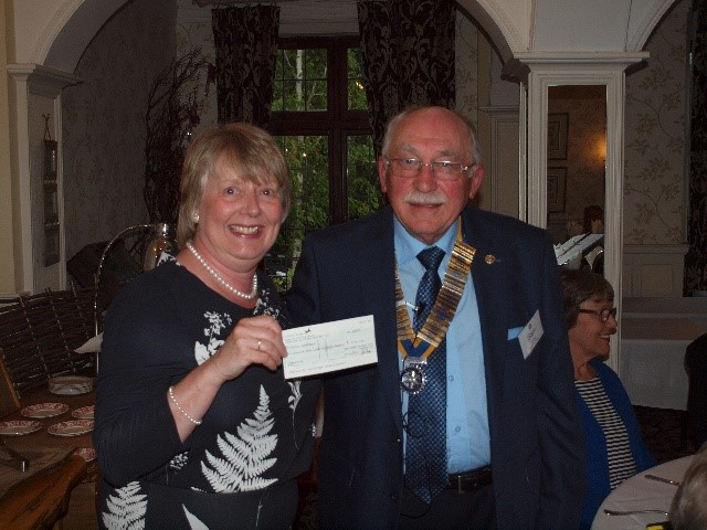 DONATIONS,  PRESENTATIONS AND OTHER SPECIAL OCCASIONS - A/President Sam presents a cheque to Tina Richardson,Events & Community Manager of Wessex Heartbeat,