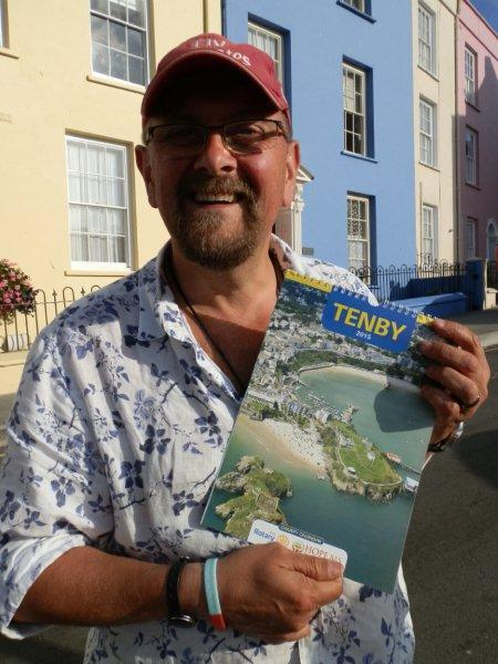 Tenby Charity Calendar on sale in Capital City - Tenby Actor Charles Dale of Casualty fame with the Tenby Charity Calendar