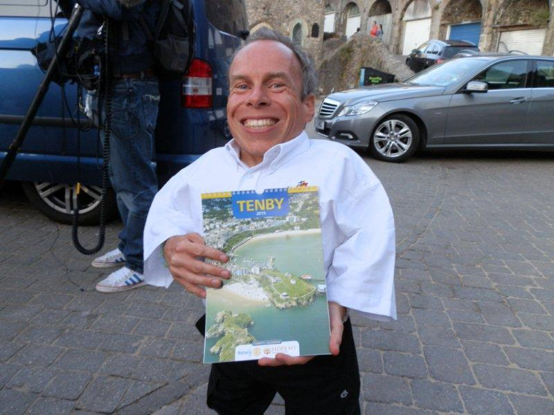 Tenby Charity Calendar on sale in Capital City - Top Actor Warwick Davies with the Tenby Charity Calendar.