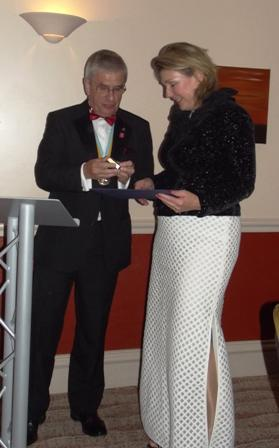 President's Dinner 23 June 2014 - receiving her Paul Harris Fellowship Award from Tim Cowling, incoming Governor D1090
