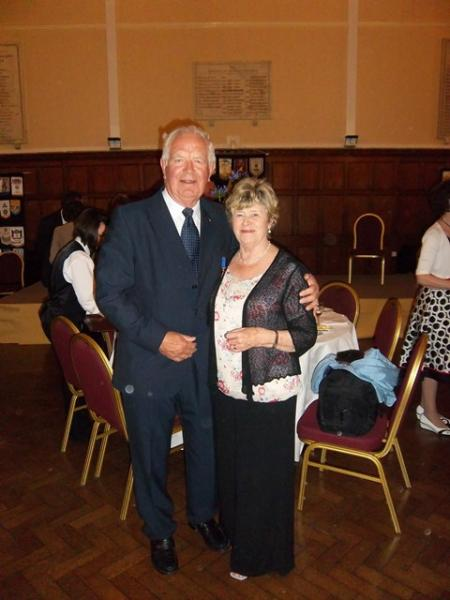 Contact Clubs Visit 2012 - Newly decorated Paul Harris Fellow Roger Hobcraft with his wife Liz at the Annual Dinner