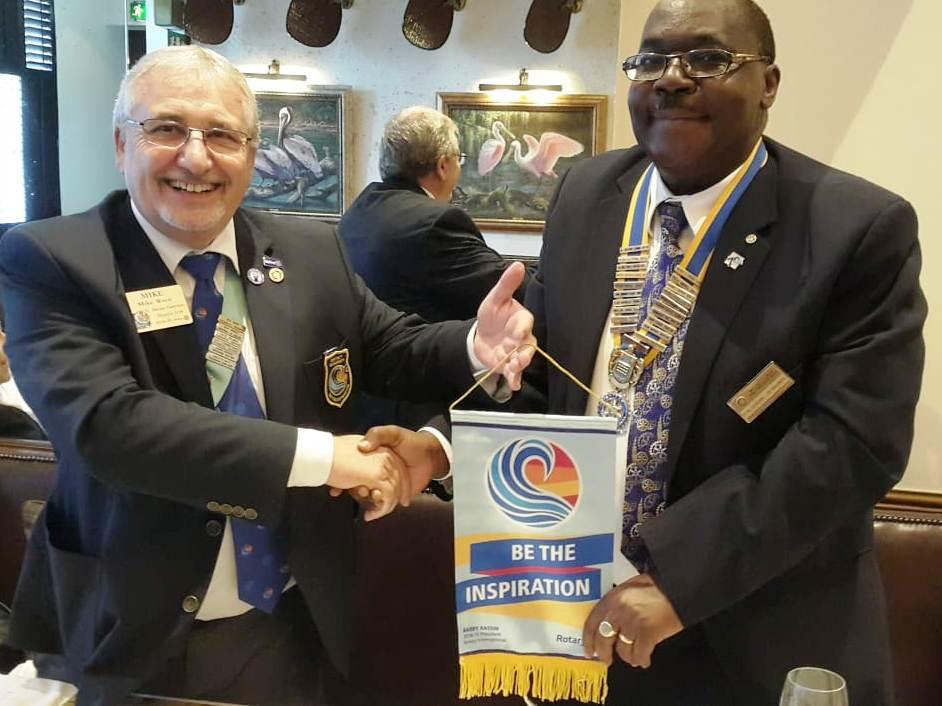 District Governor's visit on 19th September 2018 - President Juvenal receives the DG's Banner