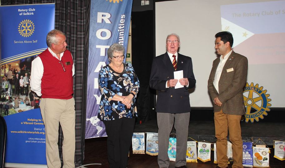 Presentation and Club Awareness Cheese and Wine Evening - John and Lina Purves, present Rotary Club with money towards Philippines Project.