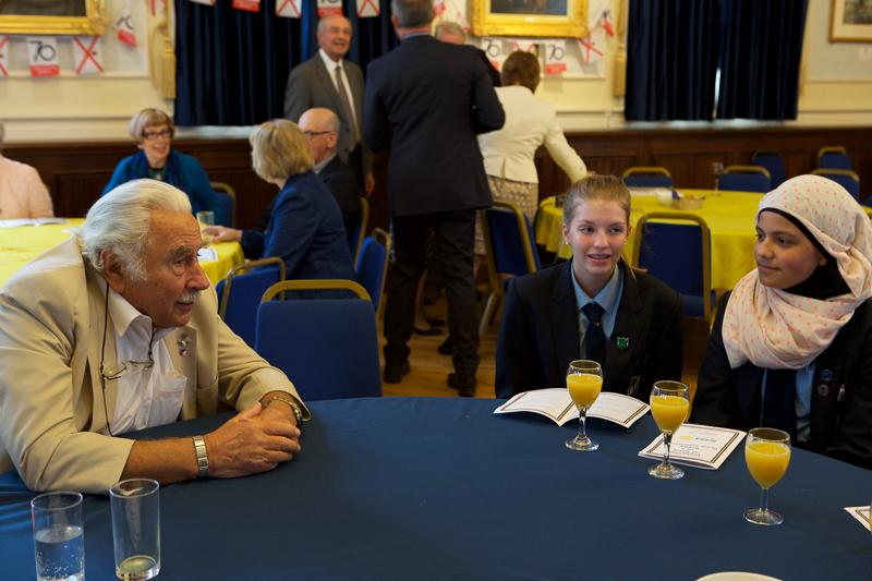 Jersey a Rotary Peace Community - Rtn. Charles Strasser with students from Grainville school.