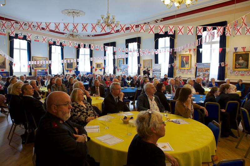 Jersey a Rotary Peace Community - The bunting decorating the room is for the Island's celebration of the 70th Anniversary of Liberation from Occupation after WW2 on 9th May 2015.