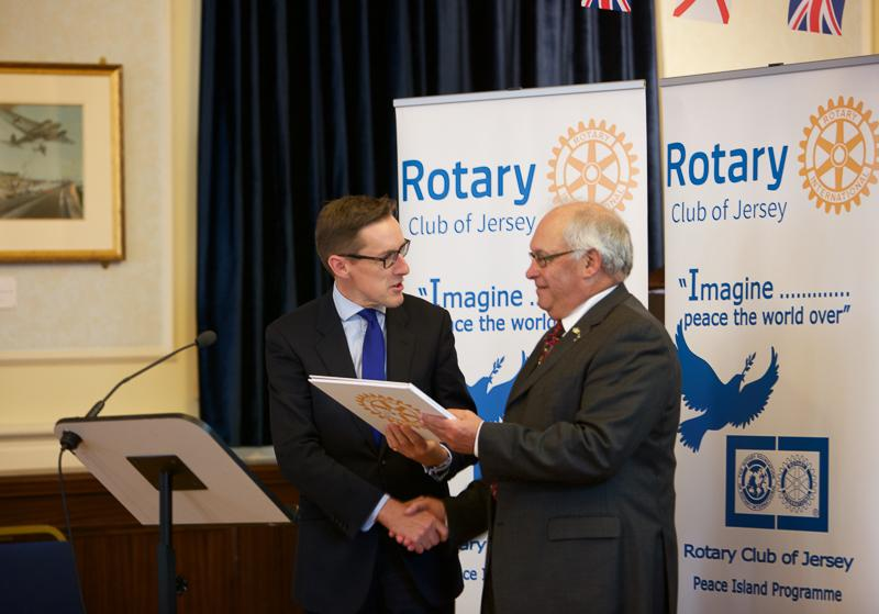 Jersey a Rotary Peace Community - The Chief Minister, Senator Ian Gorst, receives the Rotary Book of Peace on behalf of the Island of Jersey from President Ray Shead.