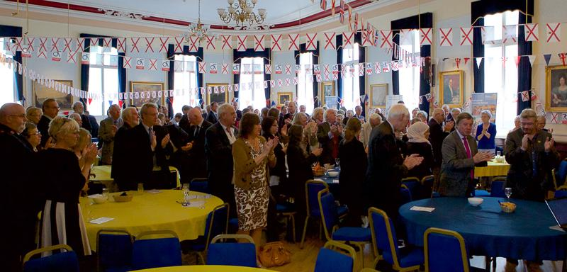 "Jersey a Rotary Peace Community - Guests rise to applaud the presentations and to join President Ray in a toast that closes all Rotary meetings at the 30,00 Rotary Clubs worldwide. ""Rotary and Peace the World Over""."