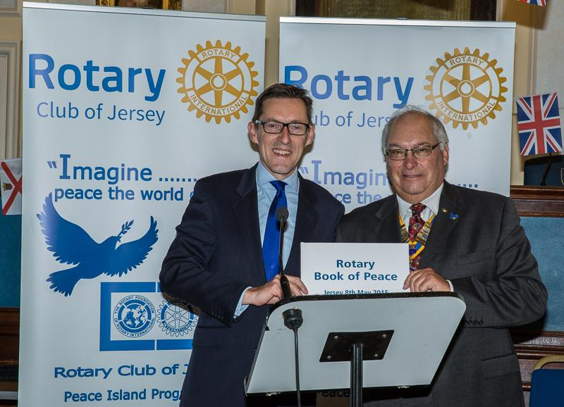 Jersey a Rotary Peace Community - Is presented to the Chief Minister, Senator Ian Gorst by President Ray, who accepts it on behalf of the island.