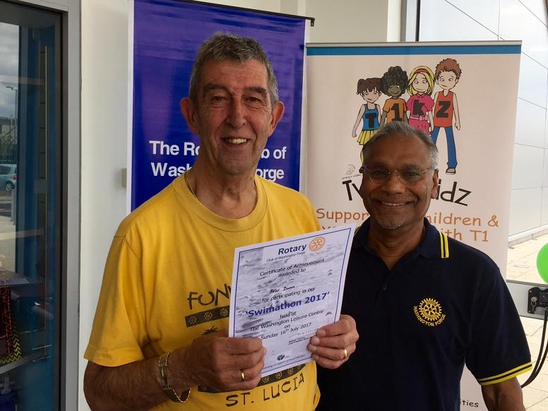 Charity Swimathon 2017 - Peter is delighted to receive his certificate to mark his participation in the swimathon.