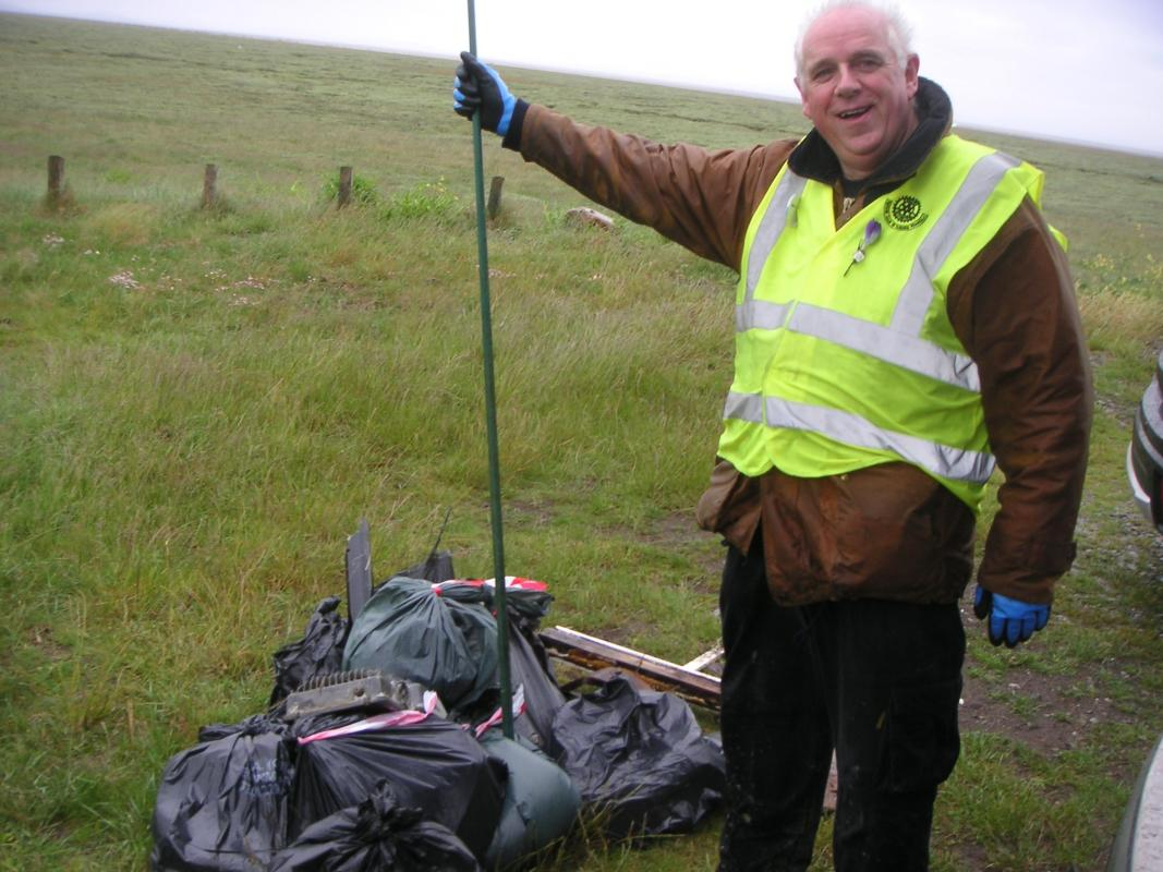 Club does its bit for the community. - Peter piles up the rubbish