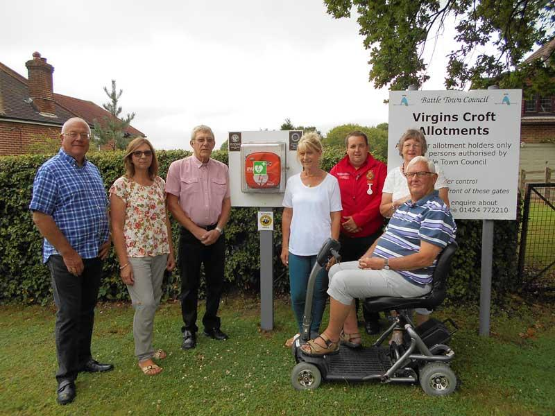 Life Saving Defibrillator for Battle Residents - Virgins Lane NHW coordinator Amada Kerr, 4th from right, Senlac Rotary's coordinator Geoff Gander 3rd from left, 10066 Community First Responder Adam Streatcher 3rdfrom right with members of the NHW and Senlac Rotary