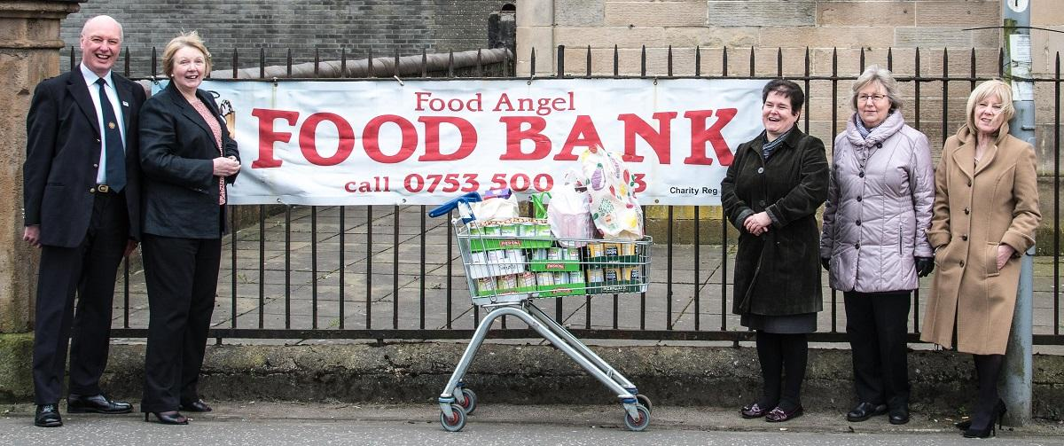 Rotarians donate to the URC Food Angel Foodbank - Rtn. Mike Kimpton stopped the traffic in Port Glasgow to take this photo