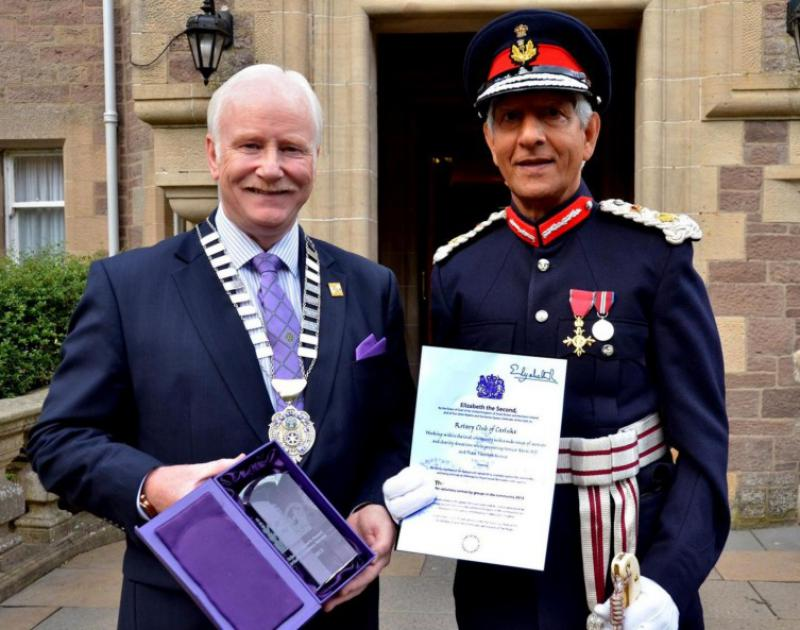 Rotary Club of Carluke - President Archie Ralston with Lord Lieutenant Mushtaq Ahmad OBE - Presentation in front of Cartland Bridge Hotel