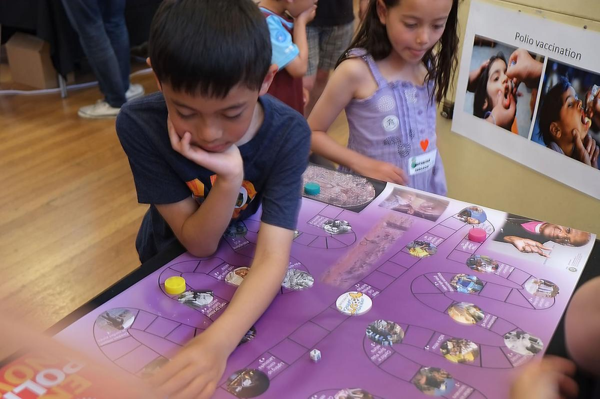 Turning Purple for Polio at Oxfordshire Science Festival - A simple board game, popular with families, traces the story of polio from Egyptian times through epidemics, iron lungs, new vaccines, Rotary's historic End Polio Now campaign