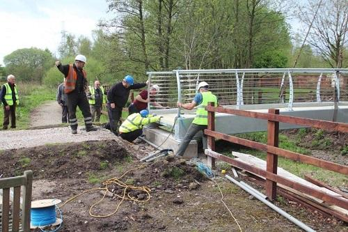 St Catherines Hospice Footbridge Construction - Positioning and preparing to bolt bridge in place